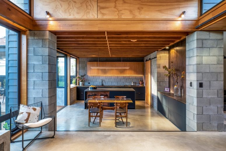Glazed walls and built-in lights fill the spaces with light and make them more inviting