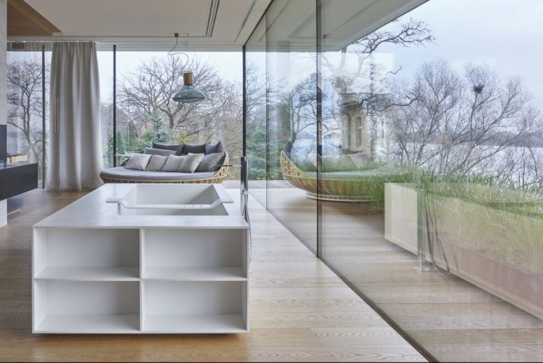 The indoor spaces are seamlessly transitioned to outdoors, the walls are glazed