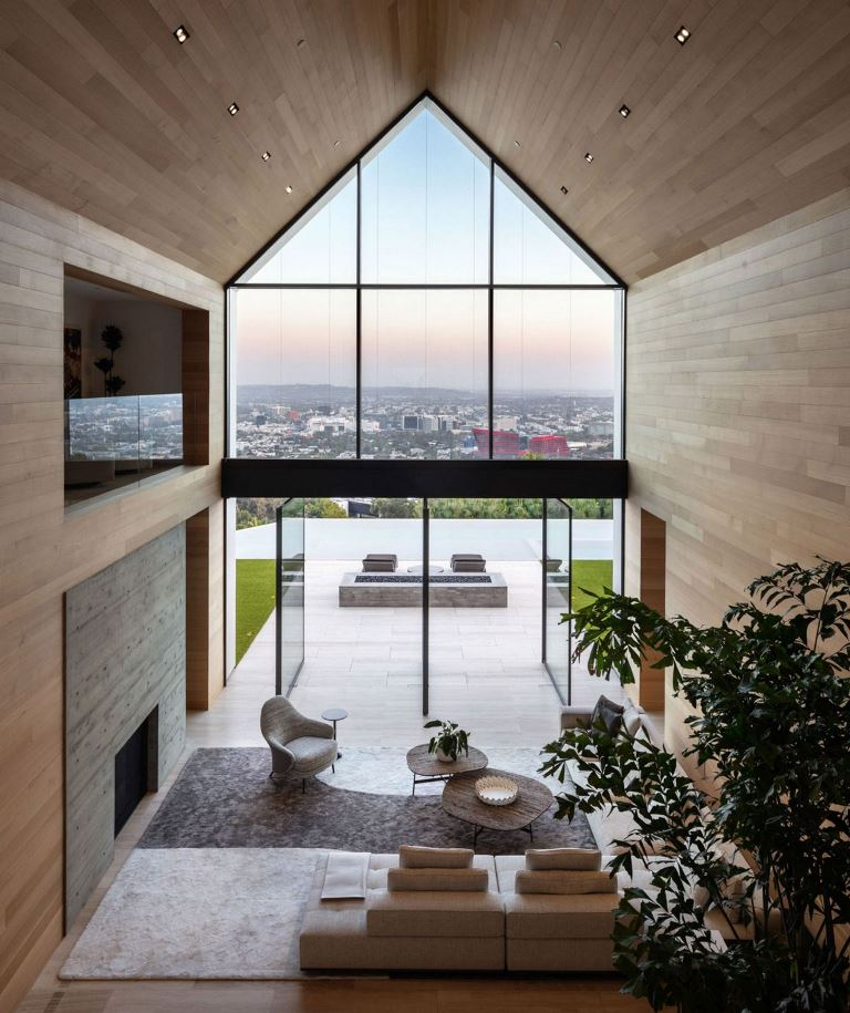 The space is clad with sleek and plain wood, there's little furniture to emphasize the views