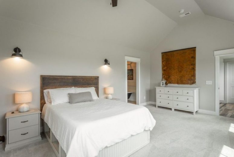 This bedroom is all-natural, with a rough wooden headboard for a cozy feel and a catchy vintage map on the wall