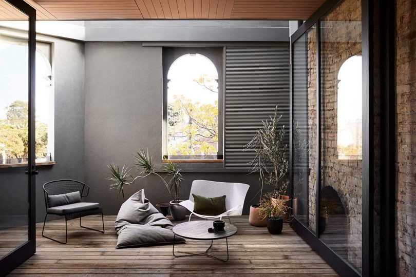 This small lounge features comfy sitting furniture, much natural light and potted plants