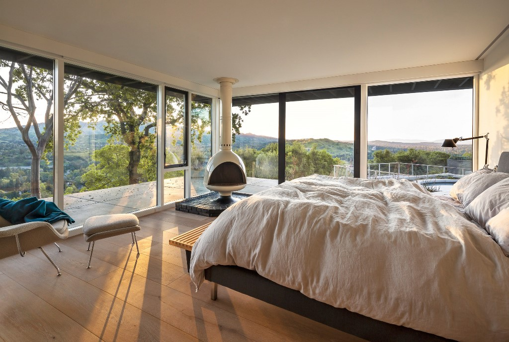 Bedrooms like this one feature fantastic views thanks to extensive glazing