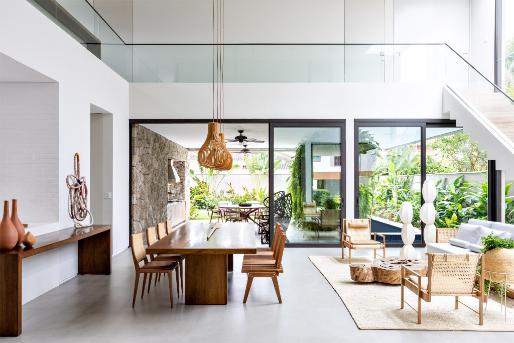The indoor spaces continue outdoors, the owners just need to open sliding doors