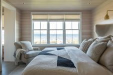 05 This bedroom is rather small and neutral but it features amazing sea views