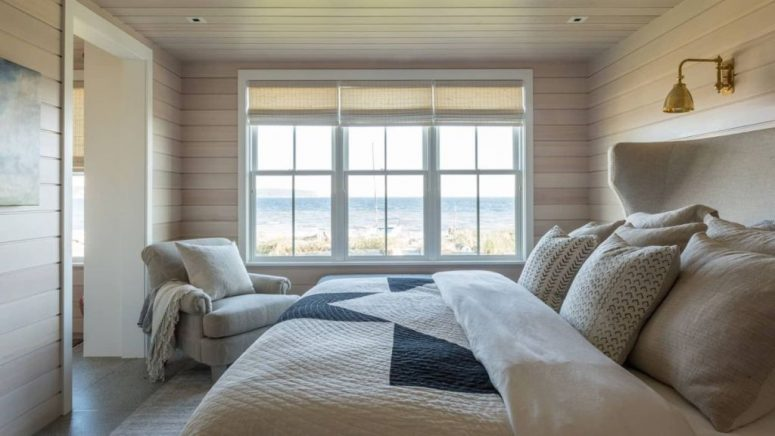 This bedroom is rather small and neutral but it features amazing sea views