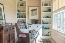 08 A reading nook was set up in front of a window, furnished with charming retro pieces