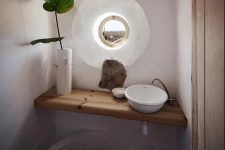a small yet cute powder room design
