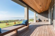 09 The covered deck is made of resilient hardwood and provides a panoramic view of the bay area