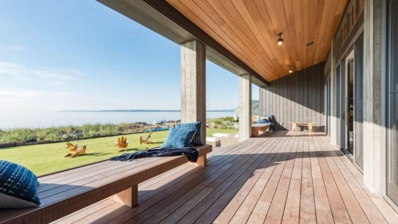 The covered deck is made of resilient hardwood and provides a panoramic view of the bay area