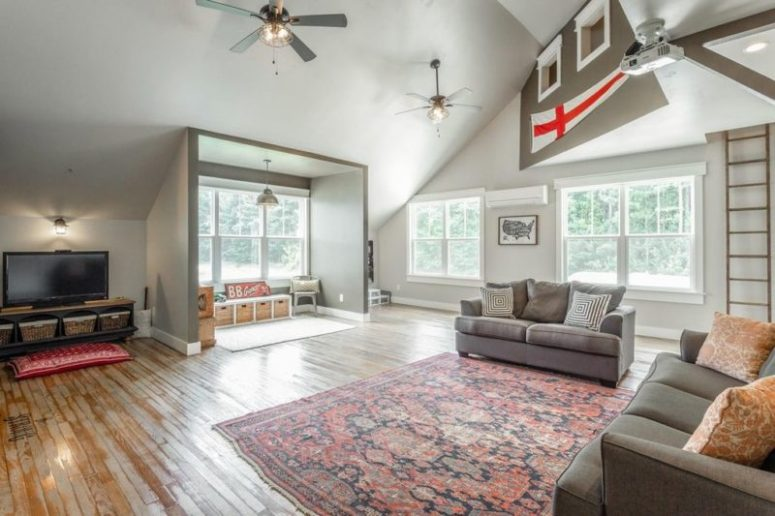 This is a bonus room with much natural light and access to a kids' play space