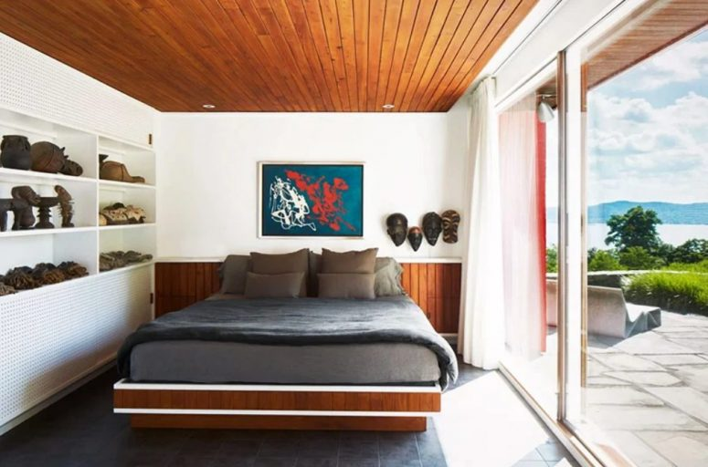 The master bedroom is decorated with tiles and stained wood, with cool furniture and lots of decor items from various travels