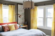 a stylish bedroom design in grey and yellow colors