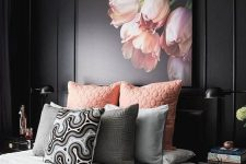 a refined moody bedroom with black walls, black furniture, pink and grey bedding and a pink floral artwork