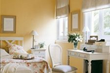 a romantic sunny yellow bedroom with refined vintage white furniture, dove grey textiles and floral bedding