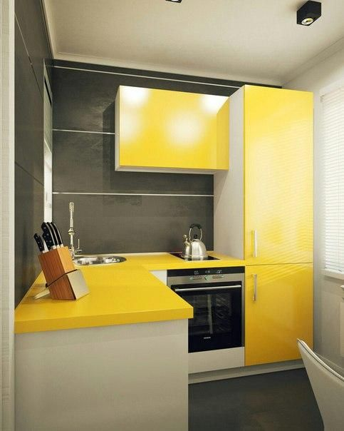 a small minimalist kitchen with bright yellow cabinets and graphite grey walls plus white touches to refresh the space