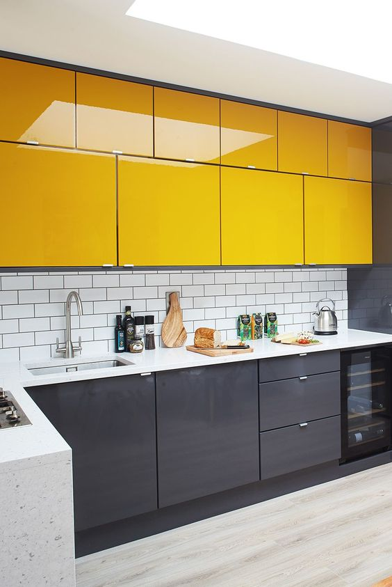 a stylish minimalist kitchen with sleek grey and sunny yellow cabinets, a white subway tile backsplash to refresh the space