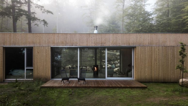 This gorgeous cedar clad cabin is in a forest area and it's a perfect getaway for a weekend or a holiday