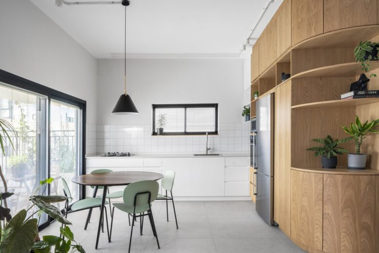 This light filled contemporary apartment is done in neutrals, it's very functional and gives all the necessary space for working from home and living