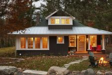 01 This rustic cabin is a stylish getaway home for a family right in the woods