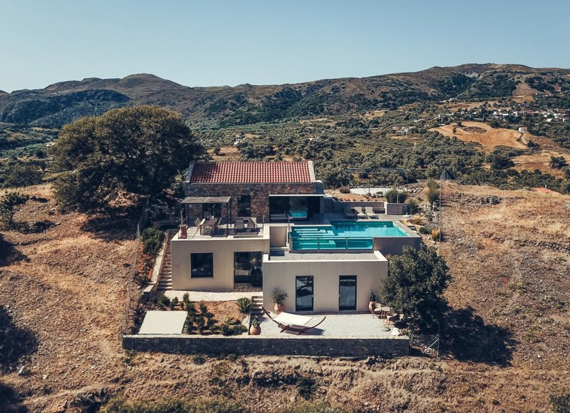 This summer house in Greece perfectly blends with the landscape and looks very stylish
