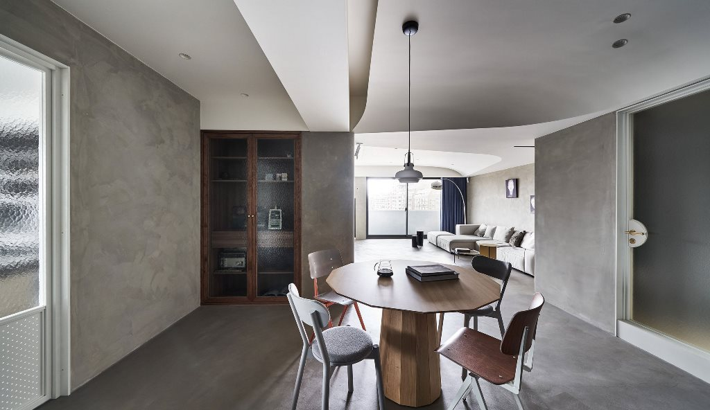 The dining space is done with a geometric table and mismatching chairs