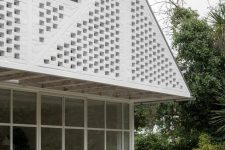 02 The facade is done with white bricks that imitate Tudor facades of the neighbors