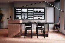 02 The kitchen is done with open facades and red pigment cement for a bold statement