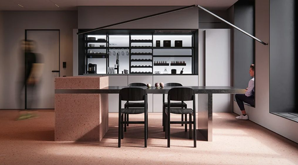 The kitchen is done with open facades and red pigment cement for a bold statement
