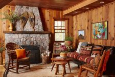 03 The living room is done with stained wood, vintage rustic furniture and a large stone hearth