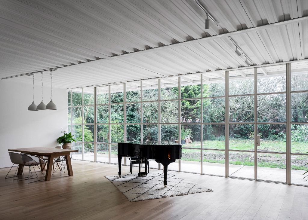 The spaces are open and filled with natural light and the decor is rather minimal