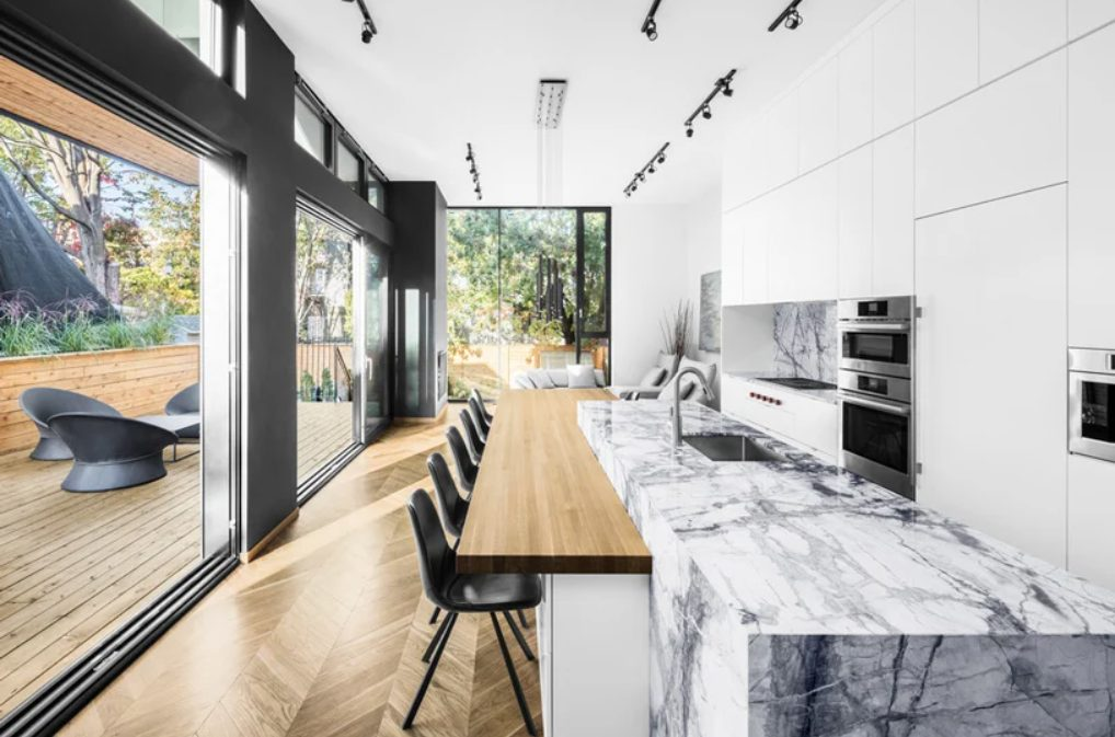 There's a large kitchen living dining layout in the extension, it's white and with a white marble kitchen island