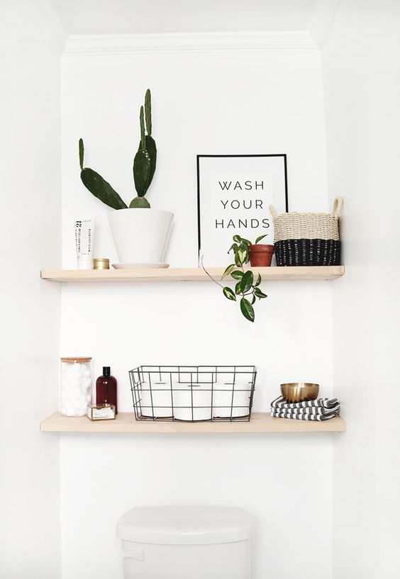 classic open shelves over the toilet are right what you need for various small stuff and even decor