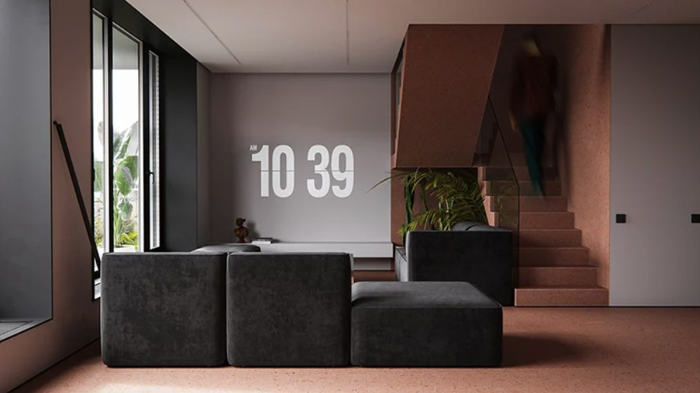 The living room is also here, it's done with elegant and comfy black furniture