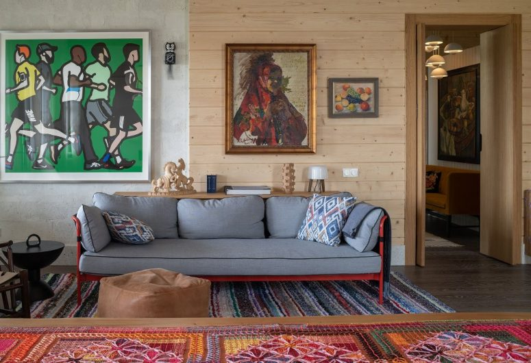 The living room shows off bright traditional textiles and neutral furniture plus bold artworks
