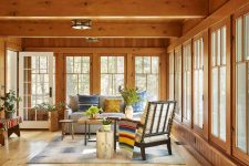 04 The sunroom is bright and fun, with bold textiles and lots of potted plants