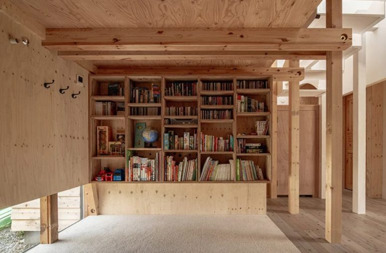 This is a reading-playing nook for the kid, with enough light and storage plus a traditional floor cover