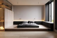 05 The bedroom is all-minimalist, with a bed on a platform and built-in lights