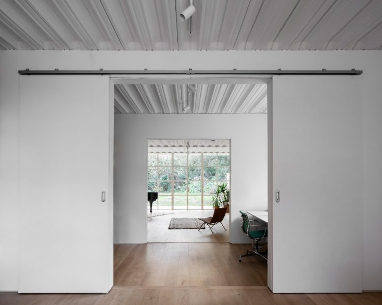 The spaces are divided with sliding doors that save space