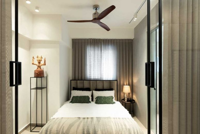 There's a small bedroom hidden behind glass doors, with a comfy bed and almost nothing else