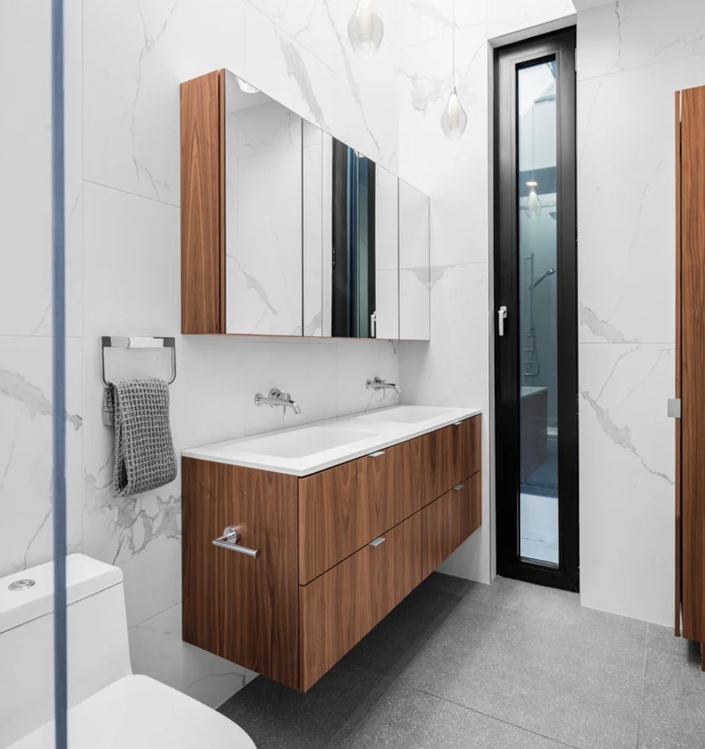 a modern bathroom with a floating vanity