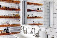 05 staiend wooden slab open shelves soften the vintage industrial bathroom making it look warmer
