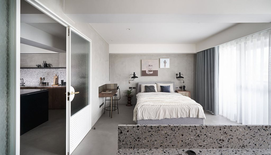The bedroom is done with a comfy bed, a floating makeup nook