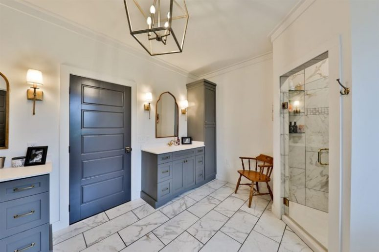 There's a comfy shower space and elegant vanities and cabinets