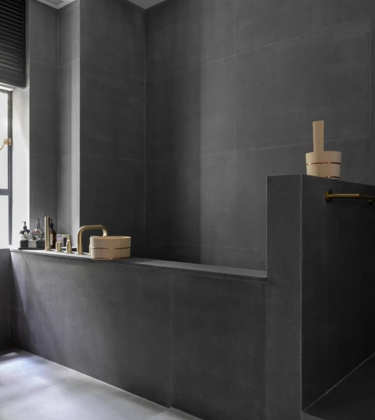 The bathroom is inspired by traditional Japanese ones as the family are Japanese