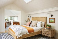 08 The guest bedroom with an additional bedroom here are done in light shades and with cozy wooden beds