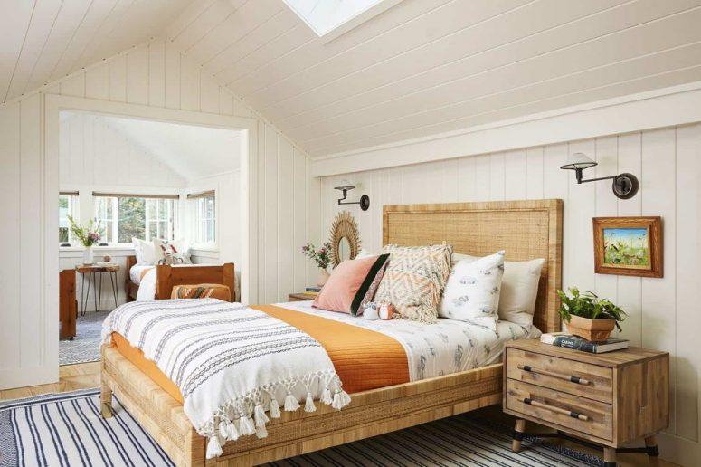 The guest bedroom with an additional bedroom here are done in light shades and with cozy wooden beds