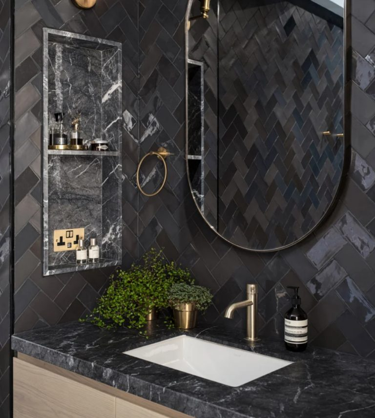 You may see elegant black marble, shiny tiles and chic gold and brass
