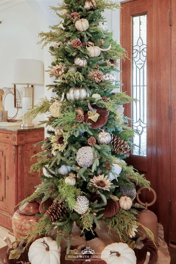 a chic Thanksgiving tree with oversized pinecones and white and metallic pumpkins, antlers, greenery and cotton balls
