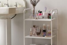 09 a stylish three-tier rolling cart will fit both a modern and vintage bathroom giving you storage space