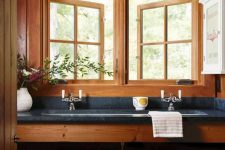 10 The master bathroom is done with stone countertops, baskets and flowers